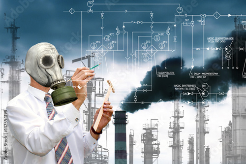 Valokuvatapetti An environmental engineer in a gas mask designs technologies for cleaning the en