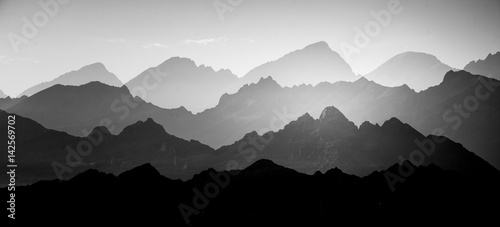Obraz A beautiful, abstract monochrome mountain landscape. Decorative, artistic look in black and white style. - fototapety do salonu
