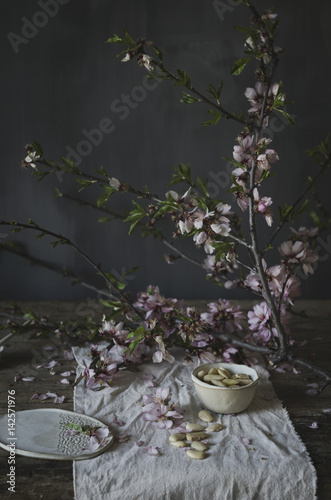 White almonds and blossom in a kitchen Poster
