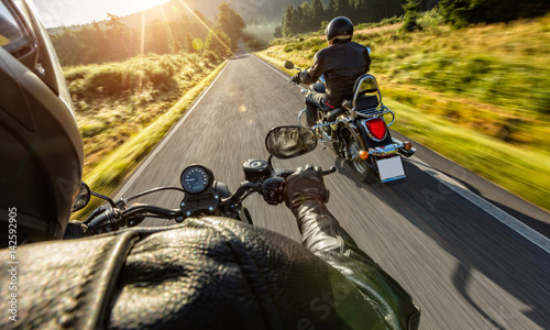 Two motorbikers riding on empty road Canvas Print