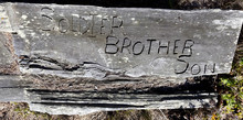 SOLDIER, BROTHER, SON Weathered Grave Marker.