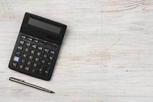 Ink Pen And Black Calculator I...