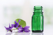 Raw materials for essential oils, organic cosmetics. Flowers with glasss bottle