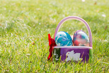 Decorated Easter Basket With Tie-dye Dyed Easter Eggs On Outside Grass In Springtime