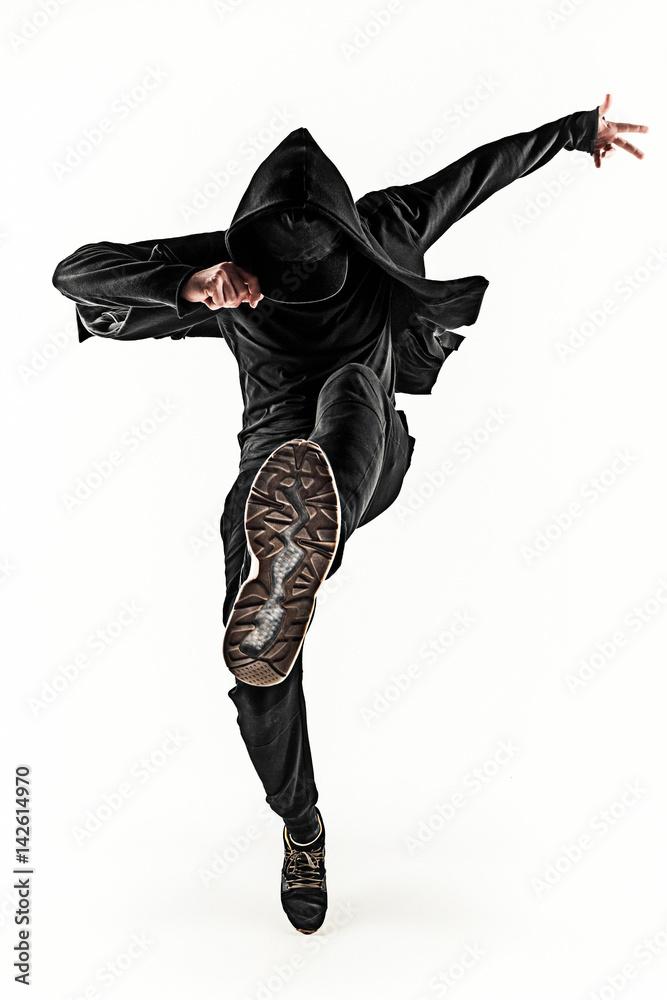Photo & Art Print The silhouette of one hip hop male break dancer ...