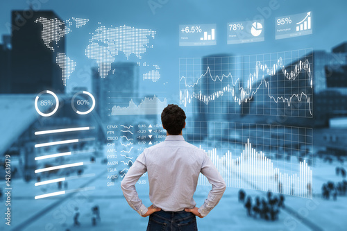 Person analyzing financial dashboard with KPI and business district background Tablou Canvas
