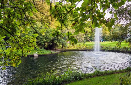 Fountain in green Queen Astrid park in Brugge, Belgium Poster