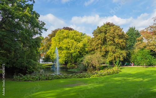 Photo  Fountain in green Queen Astrid park in Brugge, Belgium