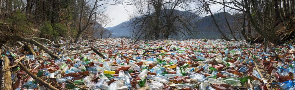 Fototapeta Bottles in the reservoir mountain