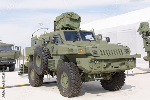 Military machines, cars and tanks on the exhibition. Heavy metal, weapon.