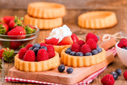 Tartlets with forest fruits. Canvas Print