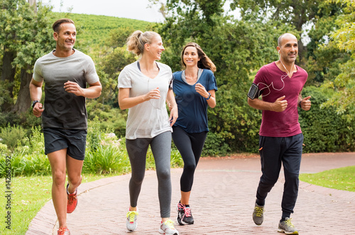 Foto auf Leinwand Jogging Group of mature people jogging