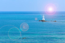 Sea And Lighthouse At Smaesarn In Thailand With Lens Flare Effect