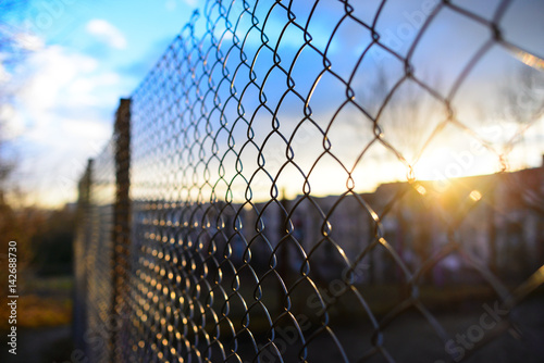 Tablou Canvas fence with metal grid in perspective