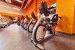 Indoor stationary bikes for spinning cycling classes. a bright orange interior