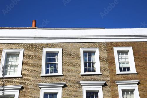 Modern stone facade on a sunny day Canvas Print