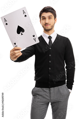 Young man holding an ace of spades card Canvas Print
