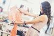Woman Choosing a Shirt at a Boutique