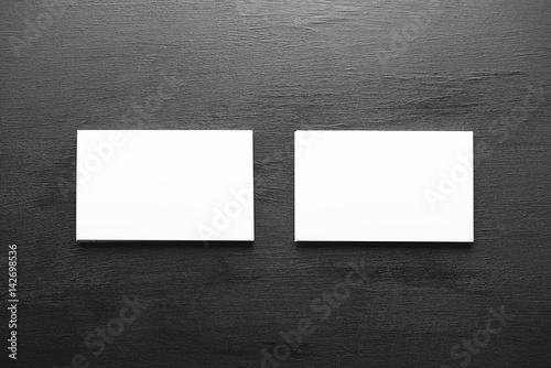 Valokuva  Business card white on black background. Business.