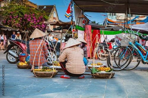 HOI AN, VIETNAM - MARCH 15, 2017: Typical street vendor in Hoi An, Vietnam