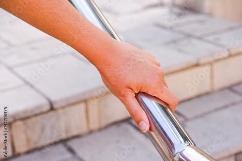 Woman hand on handrail Fototapet