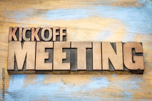 Kickoff meeting word abstract in wood type Fototapeta