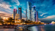 canvas print picture - Doha City in Katar bei Sonnenuntergang