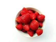Closeup White Bowl Of Fresh Strawberries On White Background.