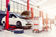 Car Repair Station With Soft-focus In The Background And Over Sunlight