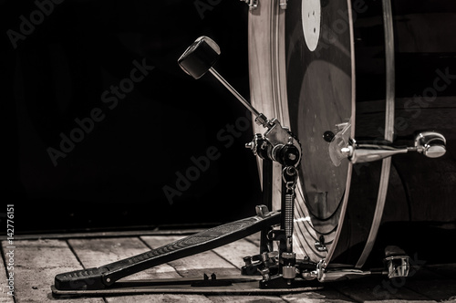 percussion instrument, bass drum with pedal on wooden boards with a black backgr Poster Mural XXL