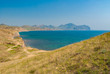 Landscape with view from Meganome cape to Fox Bay and Kara-Dag volcanic mountain range on Crimean peninsula