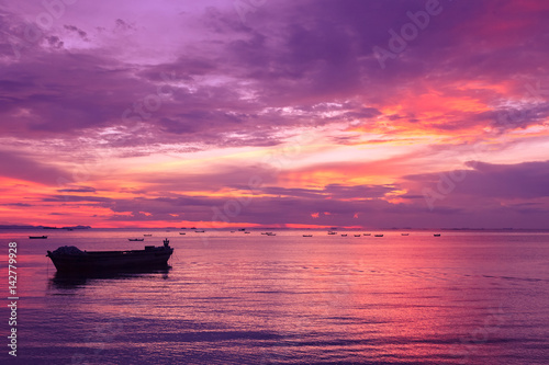 Seascape view with boats and dramatic evening sky.