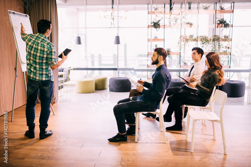 Fotografie, Obraz  Tech start-up business team discussing product roadmap for product and investmen