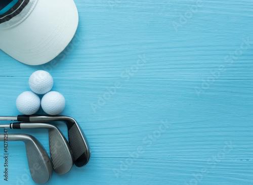 golf-clubs-golf-balls-cap-on