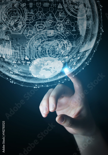 Fotografía  Businesswoman touching hologram sphere 3D rendering
