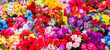 Leinwandbild Motiv A variety of artificial flowers. Colorful background of flowers