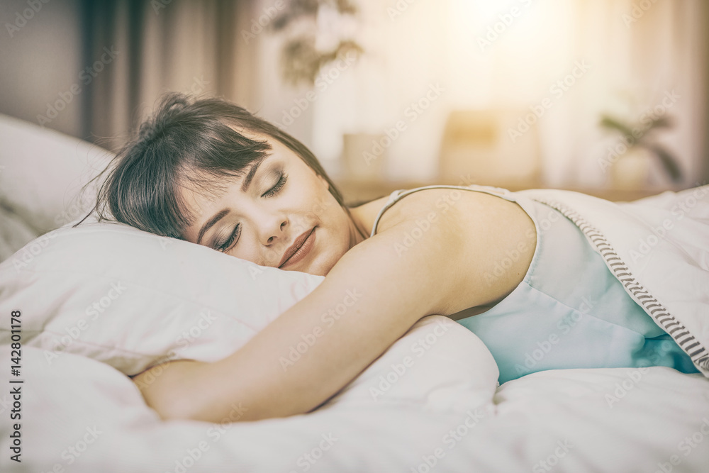 Fototapety, obrazy: Beautiful young woman sleeping on a bed in the bedroom.