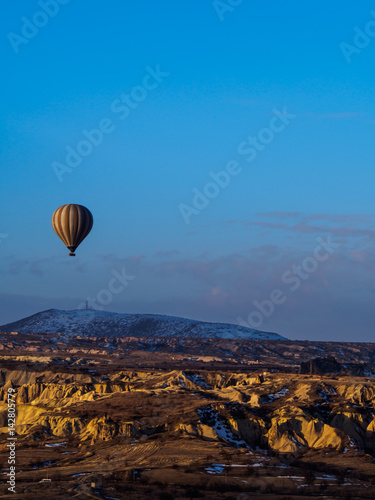 Poster Landscapes Hot air balloons flying over the mountain in Cappadocia Goreme National Park Turkey