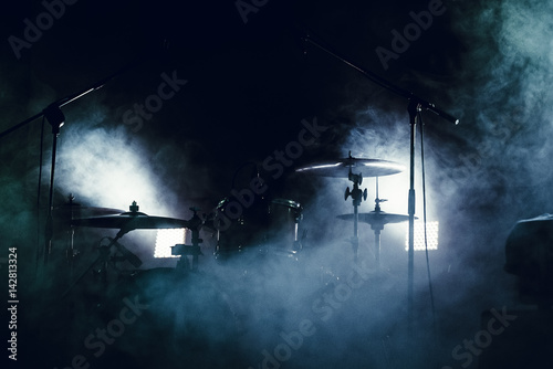 Drum set in smoke on a stage Fototapeta