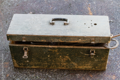Photo  Old wooden box with cracked paint to store things