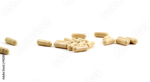 Fotografia  Drug capsule pills with beige medication in pile