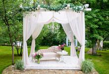Delicate Elegant Gazebo In Lush Gardens