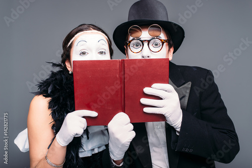 Fotografie, Tablou  Two comedy performers posing with book