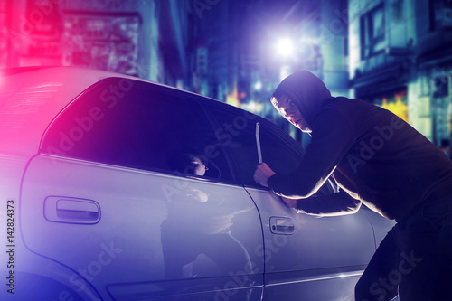 Canvas Print car thief in action at night. Car Security Theme.