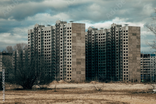 High-rise unfinished houses on wastelands Canvas Print