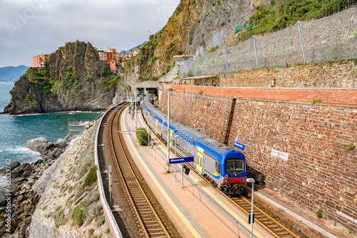 Wall Murals Northern Europe Manarola, Italy - may 12, 2016: train station with unidentified people in Manarola. Manarola is one of the 5 picturesque villages of the Cinqueterre, they are listed under UNESCO world heritage sites