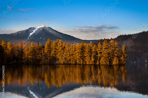 Photo Stands Reflection Snowy Whiteface mountain with reflections in Paradox Bay, Lake Placid, Upstate New York