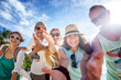 A group of young people friends 30 years walk on the beach, happy, real emotions, a vacation on the tropical shore