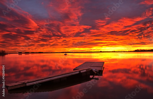 Firery Sunrise over the boat dock
