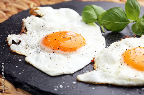 Foto auf Gartenposter Eier fried eggs with basil pepper and salt